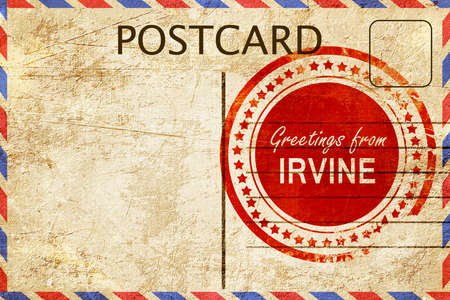 stamped: greetings from irvine, stamped on a postcard