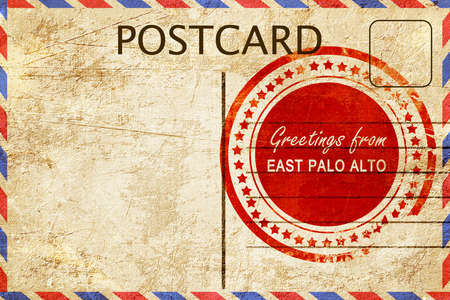stamped: greetings from east palo alto, stamped on a postcard