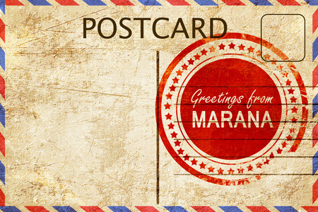 stamped: greetings from marana, stamped on a postcard