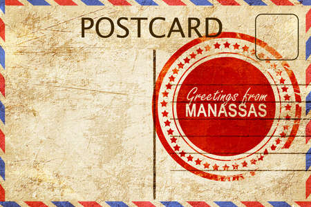 stamped: greetings from manassas, stamped on a postcard
