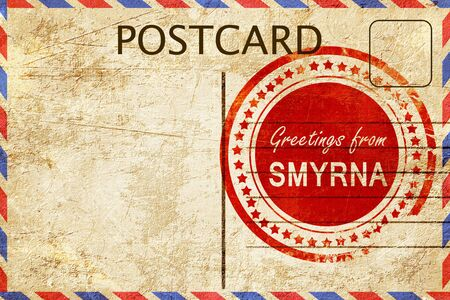 stamped: greetings from smyrna, stamped on a postcard