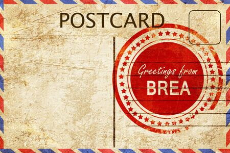stamped: greetings from brea, stamped on a postcard