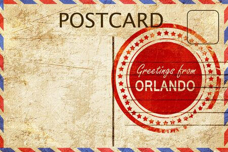 orlando: greetings from orlando, stamped on a postcard