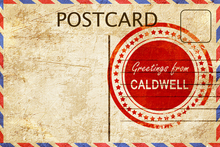 stamped: greetings from caldwell, stamped on a postcard Stock Photo