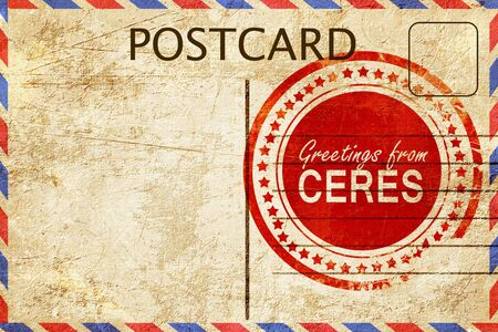 stamped: greetings from ceres, stamped on a postcard