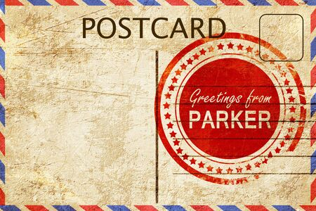 stamped: greetings from parker, stamped on a postcard