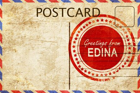 stamped: greetings from edina, stamped on a postcard
