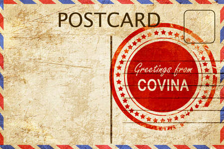 stamped: greetings from covina, stamped on a postcard