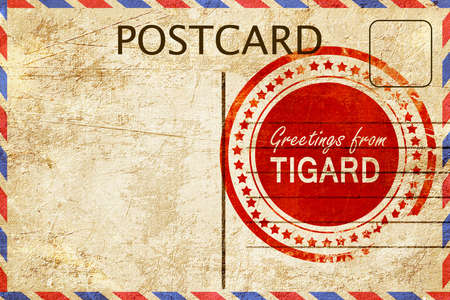 stamped: greetings from tigard, stamped on a postcard