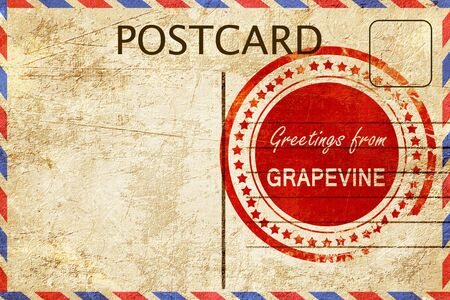 stamped: greetings from grapeville, stamped on a postcard