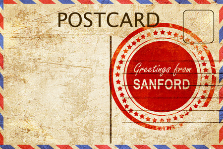 stamped: greetings from sanford, stamped on a postcard