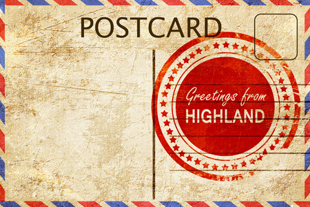 highland: greetings from highland, stamped on a postcard Stock Photo