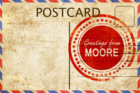 stamped: greetings from moore, stamped on a postcard