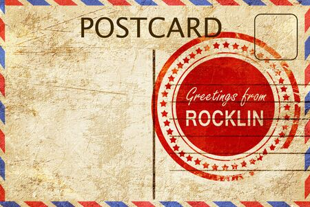 stamped: greetings from rocklin, stamped on a postcard