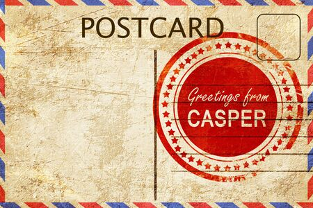 stamped: greetings from casper, stamped on a postcard