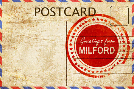 stamped: greetings from milford, stamped on a postcard