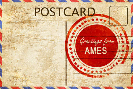 stamped: greetings from ames, stamped on a postcard
