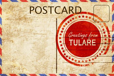 stamped: greetings from tulare, stamped on a postcard