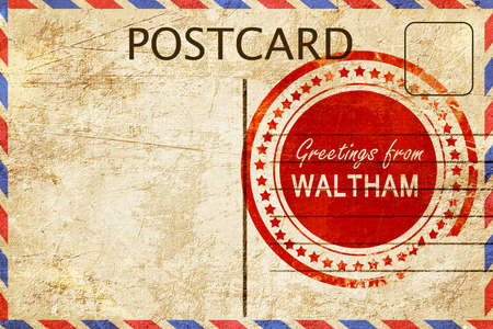 stamped: greetings from waltham, stamped on a postcard Stock Photo