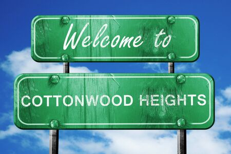 in the heights: Welcome to cottonwood heights green road sign Stock Photo
