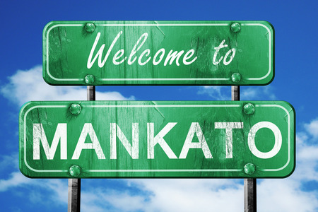 green road sign: Welcome to mankato green road sign
