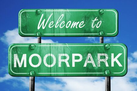 green road sign: Welcome to moorpark green road sign