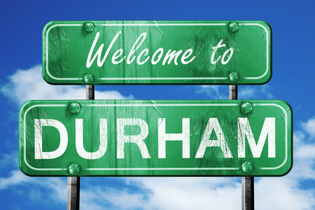 green road sign: Welcome to durham green road sign