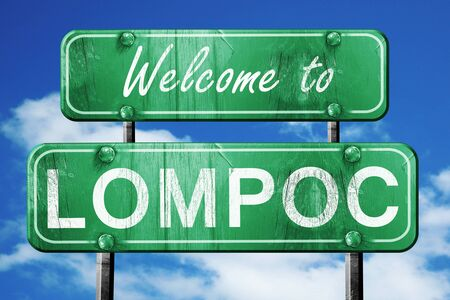 green road sign: Welcome to lompoc green road sign