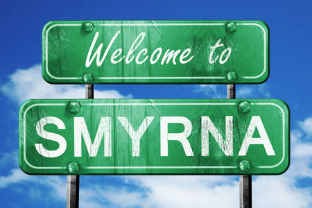 smyrna: Welcome to smyrna green road sign Stock Photo