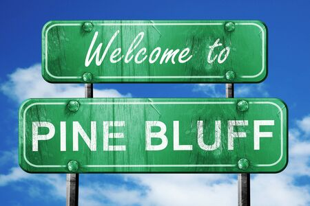 wooden board: Welcome to pine bluff green road sign