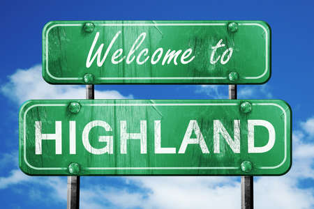 green road sign: Welcome to highland green road sign