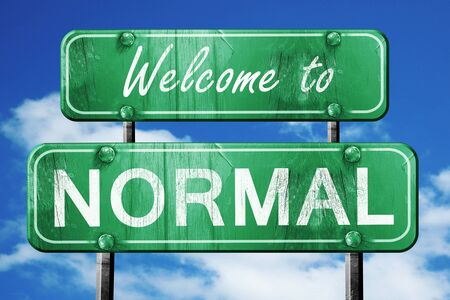 Welcome to normal green road sign Stock Photo