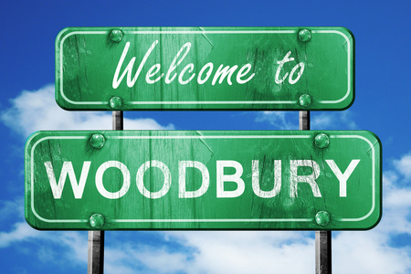 green road sign: Welcome to woodbury green road sign Stock Photo