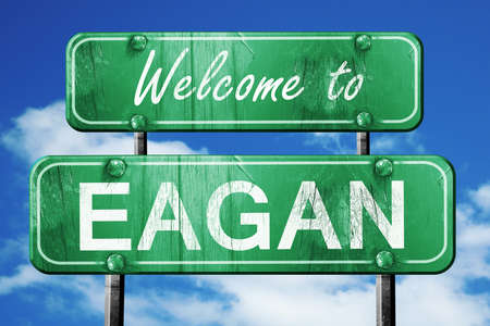 green road sign: Welcome to eagan green road sign