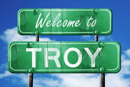green road sign: Welcome to troy green road sign