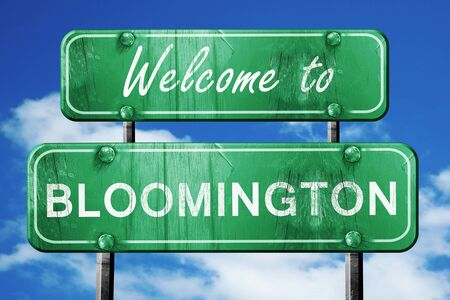 green road sign: Welcome to bloomington green road sign