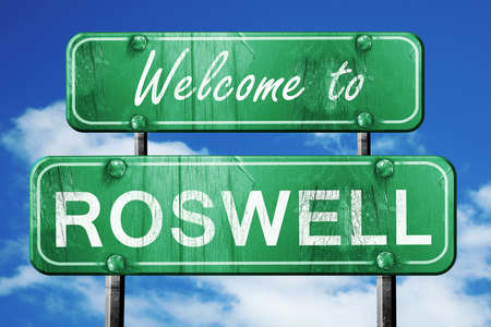 roswell: Welcome to roswell green road sign Stock Photo