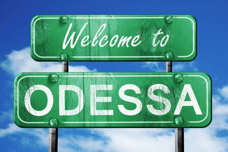 green road sign: Welcome to odessa green road sign