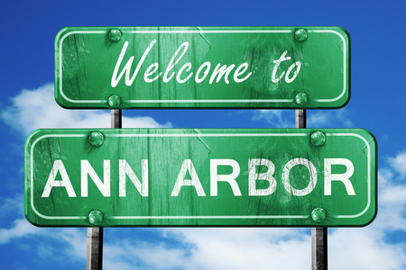 arbor: Welcome to ann arbor green road sign Stock Photo