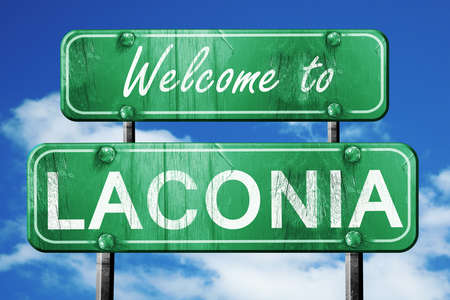 laconia: Welcome to laconia green road sign Stock Photo