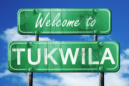 green road sign: Welcome to tukwila green road sign