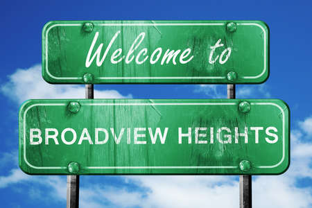 heights: Welcome to broadview heights green road sign Stock Photo