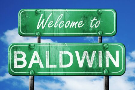 green road sign: Welcome to baldwin green road sign
