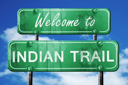 wooden trail sign: Welcome to indian trail green road sign Stock Photo
