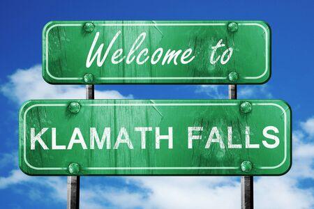 klamath: Welcome to klamath falls green road sign Stock Photo