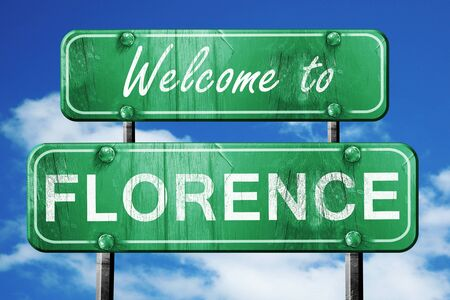 green road sign: Welcome to florence green road sign
