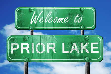 Welcome to prior lake green road sign Stock Photo