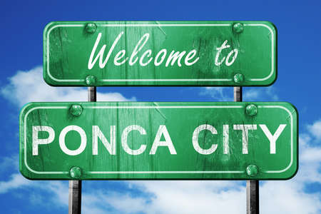 green road sign: Welcome to ponca city green road sign Stock Photo