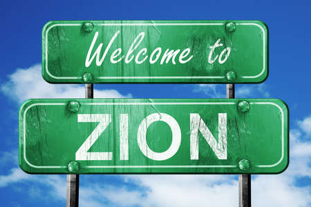 Welcome to zion green road sign Imagens