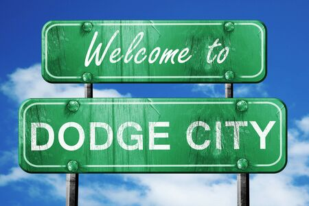 dodge: Welcome to dodge city green road sign Stock Photo